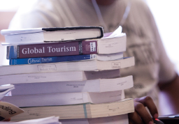 Photograph of a stack of textbooks